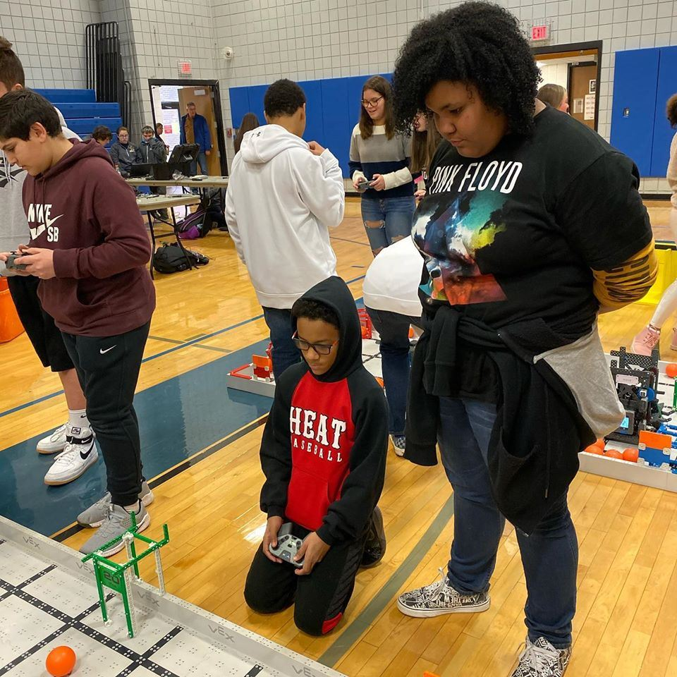 Two Robotics Students Practicing